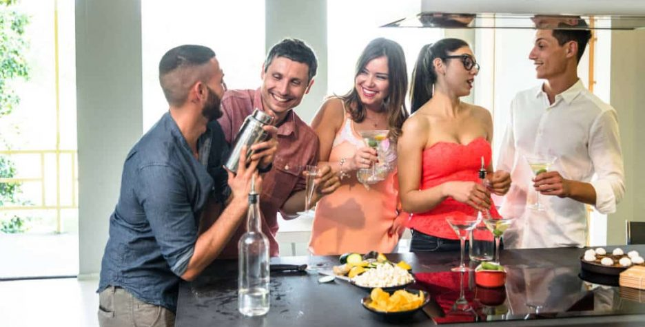 Friends gather round the glass-ceramic cooktop for good times.
